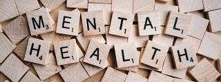 Scrabble tiles with letters spelling Mental Health